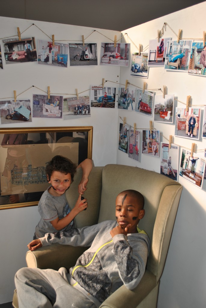Kids enjoying the installation of photography by Kat LaMiette. Very Sophisticated!