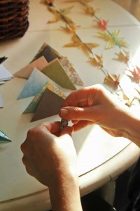 Grace Engel making origami garlands