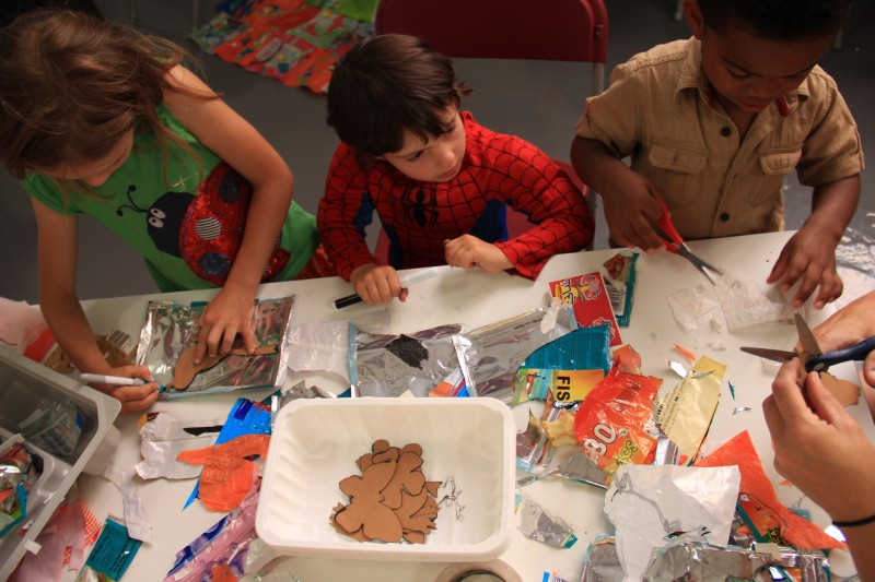 """Kids having fund during a LitterARTi creative educational workshop creating an""""un""""comfort blanket with Fiona Hobson and Jethro Brice at Trinity during our Waste of Space Exhibition."""